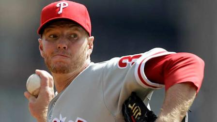Philadelphia Phillies pitcher Roy Halladay throws during the first inning of the season opening baseball game against the Pittsburgh Pirates in Pittsburgh Thursday, April 5, 2012. The Phillies won the game 1-0.