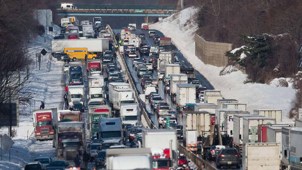 Vehicles are piled up in an accident Friday, Feb. 14, 2014, in Bensalem, Pa. Traffic accidents involving multiple tractor trailers and dozens of cars have completely blocked one side of the Pennsylvania Turnpike outside Philadelphia and caused some injuries. AP Photo/Matt Rourke