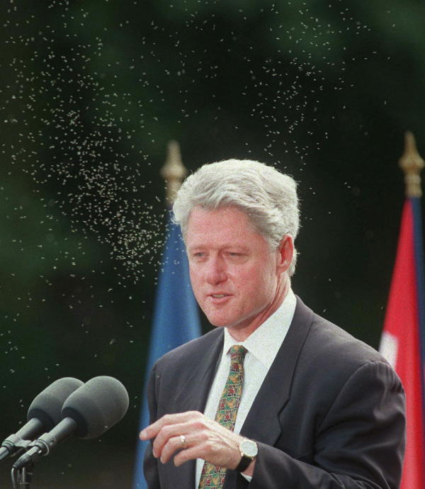 "<div class=""meta ""><span class=""caption-text "">President Clinton, is surrounded by swarms of flying insects, as he holds a press conference in Lyon, France Saturday June 29, 1996 at the conclusion of the G-7 economic summit.  ((AP Photo/Jerome Delay))</span></div>"