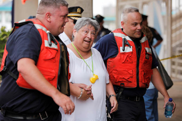 An unidentified person is escorted from the scene of a tourist boat accident on the Delaware River in Philadelphia, Wednesday, July 7, 2010. Coast Guard officials say a barge collided with a tourist duck boat on the Delaware River in Philadelphia. &#40;AP Photo&#47;Matt Rourke&#41; <span class=meta>(AP Photo&#47;Matt Rourke)</span>