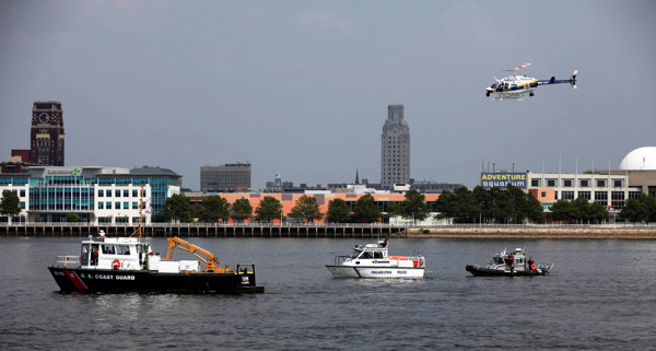 Rescue vessels are seen on the Delaware River in Philadelphia, Wednesday, July 7, 2010. Coast Guard officials say a barge collided with a tourist duck boat on the Delaware River in Philadelphia. &#40;AP Photo&#47; Joseph Kaczmarek&#41; <span class=meta>(AP Photo&#47; Joseph Kaczmarek)</span>