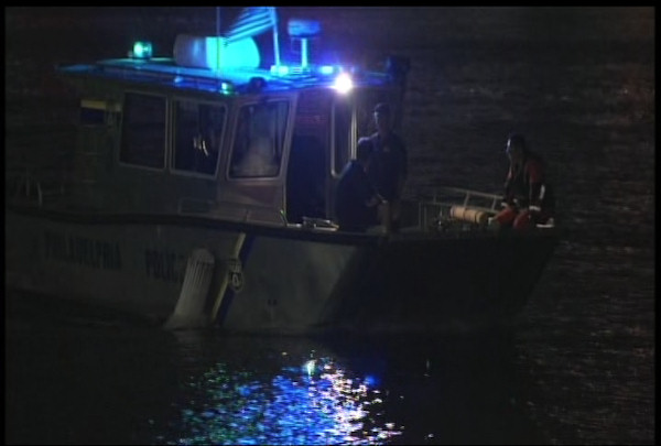 The Philadelphia Police search the scene of the 'Ride the Ducks' boat accident on July 7, 2010.