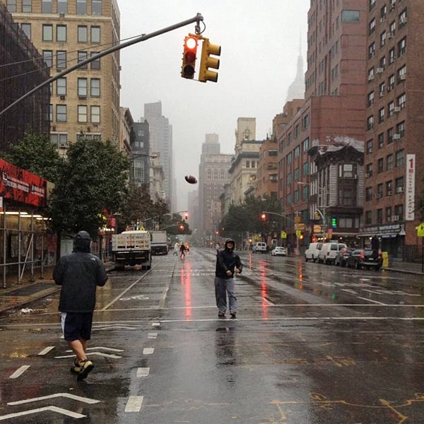 Two men play football in the street in New York City on Monday, Oct. 29, 2012 as superstorm Sandy approaches the East Coast. <span class=meta>(Instagram&#47;TheTroyReport)</span>