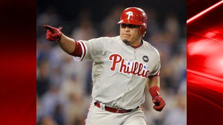 Philadelphia Phillies Carlos Ruiz hits a three-run home run during the fifth inning of Game 1 of the National League Championship baseball series against the Los Angeles Dodgers Thursday, Oct. 15, 2009, in Los Angeles. (AP Photo/Chris Carlson)