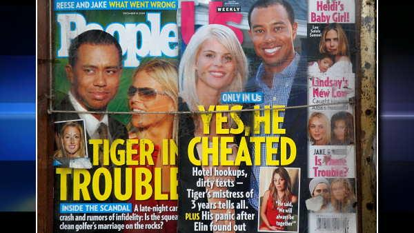 Tiger Woods appears with his wife Elin in photographs on the cover of People and Us weekly magazines displayed