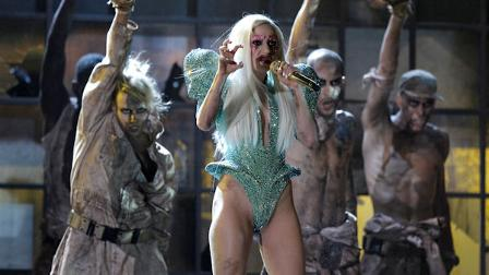 Lady Gaga, center, performs at the Grammy Awards on Sunday, Jan. 31, 2010, in Los Angeles. (AP Photo/Matt Sayles)