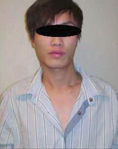 "<div class=""meta ""><span class=""caption-text "">During the flight, officials say he went into a bathroom, took off the disguise and emerged as a young Asian.  (CNN/Canada Border Service)</span></div>"