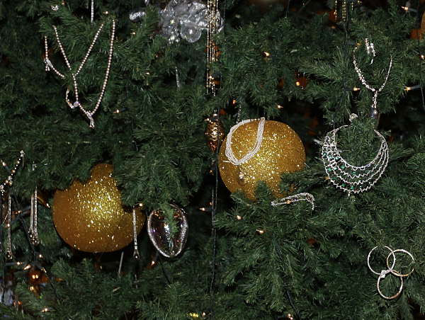 Golden necklaces are seen among the other decorations adorning a Christmas tree which has been decked out with dollars 11 million U.S. &#40;14.3 million euro&#41; worth of gold, at the Emirates Palace hotel, in Abu Dhabi, United Arab Emirates, on Thursday Dec. 16, 2010. The hotel&#39;s general manager, Hans Olbertz, was quoted in local newspapers Thursday as saying the 43-foot &#40;13-meter&#41; faux fir has 131 ornaments that include gold and precious stones including diamonds and sapphires. The &#36;11 million symbol of the season has become the latest extravagance at the Emirates Palace hotel, which boasts its own marina, heliport and a vending machine that pops out small gold bars. <span class=meta>(AP Photo)</span>
