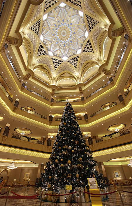 A Christmas tree which has been decked out with dollars 11 million U.S. &#40;14.3 million euro&#41; worth of gold and precious stones, stands under the dome of the Emirates Palace hotel, in Abu Dhabi, United Arab Emirates, on Thursday Dec. 16, 2010. The hotel&#39;s general manager, Hans Olbertz, was quoted in local newspapers Thursday as saying the 43-foot &#40;13-meter&#41; faux fir has 131 ornaments that include gold and precious stones including diamonds and sapphires. The &#36;11 million symbol of the season has become the latest extravagance at the Emirates Palace hotel, which boasts its own marina, heliport and a vending machine that pops out small gold bars. <span class=meta>(AP Photo)</span>