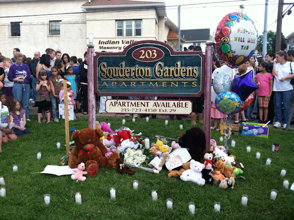 "<div class=""meta ""><span class=""caption-text "">A vigil is held for 9-year-old Skyler Kauffman outside the Souderton Gardens Apartments on Tuesday, May 10, 2011, where police say she was murdered after she went missing a day earlier. </span></div>"