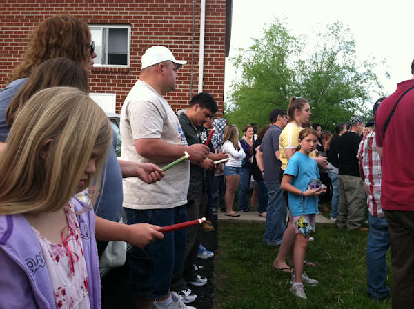A vigil is held for 9-year-old Skyler Kauffman outside the Souderton Gardens Apartments on Tuesday, May 10, 2011, where police say she was murdered after she went missing a day earlier.