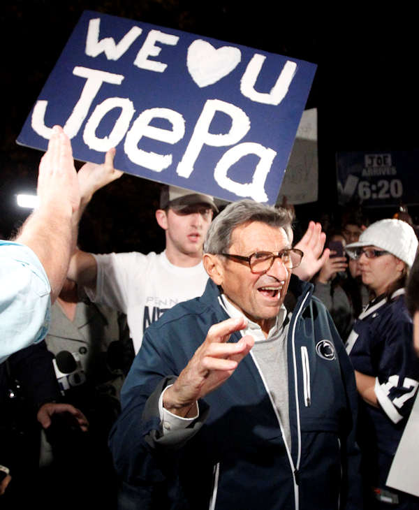 "Students greet Penn State coach Joe Paterno as he arrives at his home, Tuesday, Nov. 8, 2011, in State College, Pa. Paterno's support among the Penn State board of trustees was described as ""eroding"" Tuesday, threatening to end the 84-year-old coach's career amid a child sex-abuse scandal involving a former assistant and one-time heir apparent. (AP Photo/Matt Rourke)"