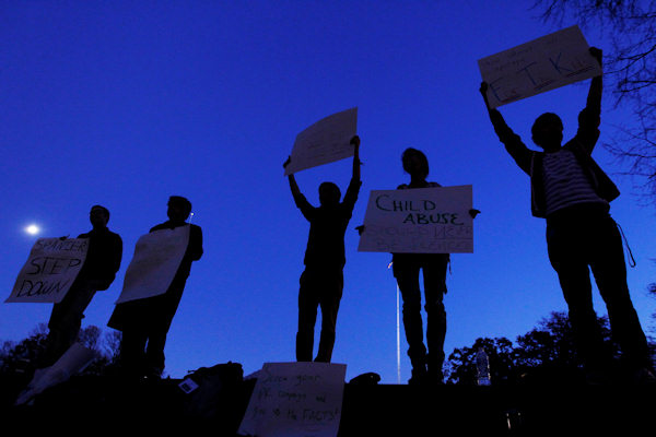 Protestors call for the resignation of Penn State University's president Graham Spanier amid a child sex-abuse scandal involving a former football assistant, Tuesday, Nov. 8, 2011, on the school's campus. (AP Photo/Matt Rourke)