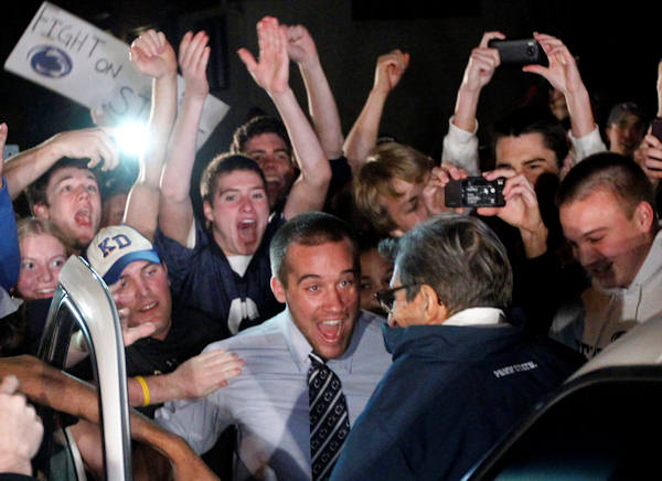 "<div class=""meta image-caption""><div class=""origin-logo origin-image ""><span></span></div><span class=""caption-text"">Students greet Penn State coach Joe Paterno as he arrives at his home, Tuesday, Nov. 8, 2011, in State College, Pa. Paterno's support among the Penn State board of trustees was described as ""eroding"" Tuesday, threatening to end the 84-year-old coach's career amid a child sex-abuse scandal involving a former assistant and one-time heir apparent. (AP Photo/Matt Rourke)</span></div>"
