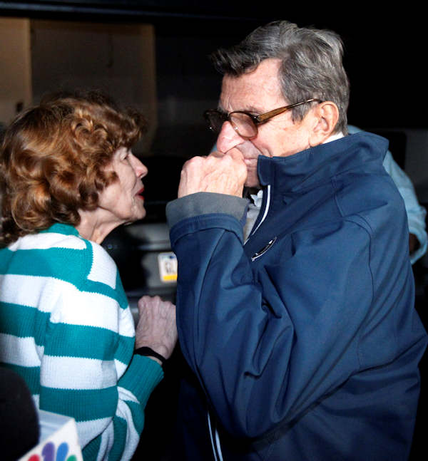 "Penn State football coach Joe Paterno and his wife, Sue Paterno, react after he arrived at his home, Tuesday, Nov. 8, 2011, in State College, Pa. Paterno's support among the Penn State board of trustees was described as ""eroding"" Tuesday, threatening to end the 84-year-old coach's career amid a child sex-abuse scandal involving a former assistant and one-time heir apparent. (AP Photo/Matt Rourke)"
