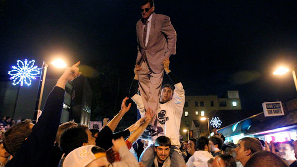 "<div class=""meta ""><span class=""caption-text "">Penn State students and others gather off campus, one holding a cutout of football coach Joe Paterno, Wednesday, Nov. 9, 2011, in State College, Pa., after the firing of Paterno and university president Graham Spanier. (AP Photo/Matt Rourke) </span></div>"