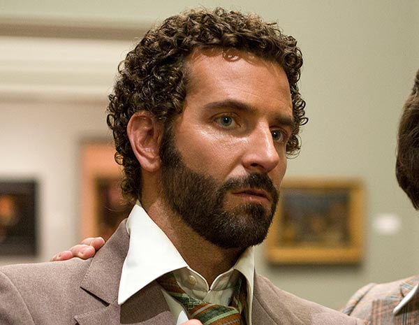 "BEST SUPPORTING ACTOR NOMINEE: This film image released by Sony Pictures shows Bradley Cooper in a scene from ""American Hustle."" Cooper was nominated for an Academy Award for best supporting actor on Thursday, Jan. 16, 2014. The 86th Academy Awards will be held on March 2. (AP Photo/Sony - Columbia Pictures, Francois Duhamel)"