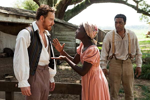 "BEST SUPPORTING ACTOR NOMINEE: This film publicity image released by Fox Searchlight shows, Michael Fassbender, from left, Lupita Nyong'o and Chiwetel Ejiofor in a scene from ""12 Years A Slave."" Fassbender was nominated for an Academy Award for best supporting actor on Thursday, Jan. 16, 2014. The 86th Academy Awards will be held on March 2. (AP Photo/Fox Searchlight Films, Francois Duhamel)"