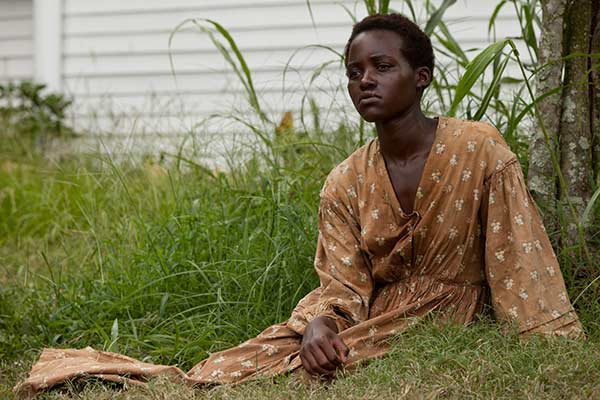 "BEST SUPPORTING ACTRESS NOMINEE: This image released by Fox Searchlight shows Lupita Nyong'o in a scene from ""12 Years A Slave."" Nyong'o was nominated for an Academy Award for best supporting actress on Thursday, Jan. 16, 2014. The 86th Academy Awards will be held on March 2. (AP Photo/Fox Searchlight, Francois Duhamel)"