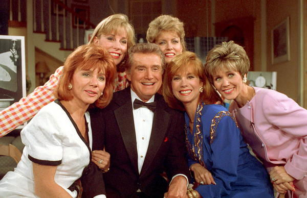 ABC-TV talk show host Regis Philbin celebrates 30 years on the air and is joined by present and past co-hosts during a special one-hour live show in New York City, Friday, May 15, 1992. Seated second from right is present co-host Kathy Lee, and past co-hosts from left are, Philbin&#39;s wife, Joy, Sarah Purcell, Mary Hart and Ann Abernathy.  <span class=meta>(AP Photo&#47;Steve Freeman)</span>