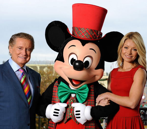 In this photo released by Disney, Regis Philbin, left, and Kelly Ripa pose with a holiday-clad Mickey Mouse, Saturday, Dec. 6, 2008 at the Magic Kingdom in Lake Buena Vista, Fla., while taping the &#34;Walt Disney World Christmas Day Parade,&#34; to be aired nationwide Dec. 25 on ABC-TV. Special guest performers include Miley Cyrus, Billy Ray Cyrus, Jose Feliciano, Corbin Bleu, the Jonas Brothers, David Cook, the Imagination Movers and Sarah Brightman. Philbin and Ripa once again host the Christmas special, which marks its 25th anniversary this year.  <span class=meta>(AP Photo&#47;Disney, Mark Ashman)</span>