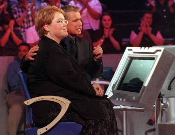 Regis Philbin hosts &#34;Who Wants to be a Millionaire,&#34; ABC&#39;S new quiz show that offers contestants the opportunity to become an instant millionaire. Hillary Daw, left, from Kennesaw, Ga., is a contestant on the series&#39; premiere airing Monday, Aug. 16 at 8:30 p.m, EDT.  <span class=meta>(Photo&#47;AP Photo)</span>