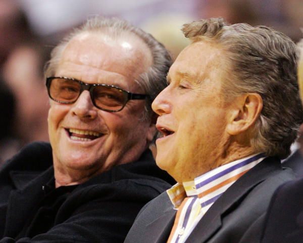 Actor Jack Nicholson, left, chats with talk show host Regis Philbin during the first half of the Los Angeles Lakers' NBA basketball game against the New Orleans Hornets, Wednesday night, April 19, 2006, in Los Angeles.