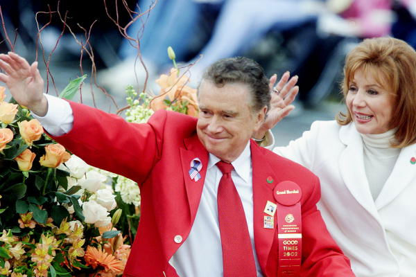 Grand Marshal Regis Philbin, host of television&#39;s &#34;Who Wants to Be a Millionaire,&#34; and his wife Joy wave to the crowd as they make their way down Colorado Boulevard in the 113th annual Rose Parade Tuesday, Jan. 1, 2002, in Pasadena, Calif.  <span class=meta>(AP Photo&#47;Damian Dovarganes)</span>