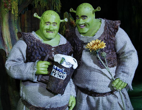 "<div class=""meta ""><span class=""caption-text "">In this image released by Disney-ABC Domestic Television, ""Live with Regis and Kelly,"" host Regis Philbin, left, dressed as the character Shrek, poses with Brian d?Arcy James, star of the Broadway musical ""Shrek the Musical,"" taped on April 22, 2009, in New York. Hosts Regis Philbin and Kelly Ripa hit Broadway, performing in some of their favorite shows this week in a segment called ""On Broadway."" The Shrek segment aired on Friday, May 1.  (AP Photo/Disney-ABC Domestic Television)</span></div>"
