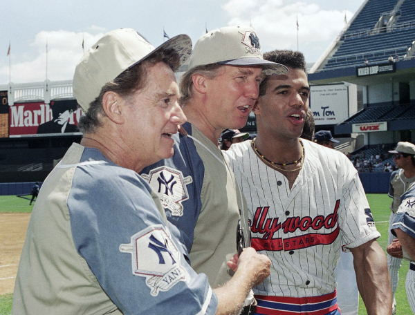Television talk host Regis Philbin, left, real estate developer Donald Trump, center, and daytime television actor Kristoff St. John, who plays Neil Winters in ?The Young and The Restless? pose for photographers prior to the third annual celebrity softball game at Yankee Stadium in New York on Saturday, July 31, 1993. The game pitted the Donald Trump All-Stars against the Hollywood All-Stars.  <span class=meta>(AP Photo&#47;Paul Hurschmann)</span>