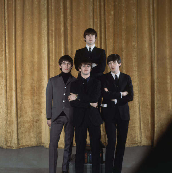 "The Beatles are shown on the set of the ""Ed Sullivan Show"" in New York, Feb. 10, 1964. In back is John Lennon; the others, from left to right, are: George Harrison, Ringo Starr and Paul McCartney. (AP Photo)"