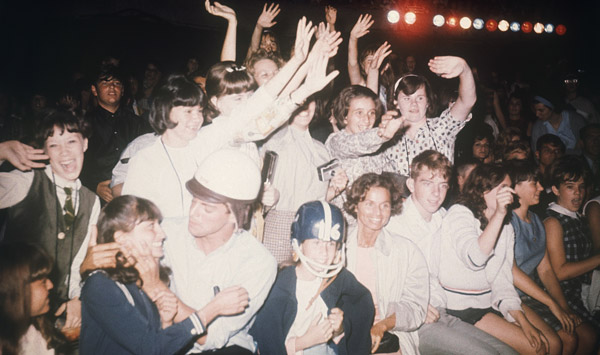 "<div class=""meta image-caption""><div class=""origin-logo origin-image ""><span></span></div><span class=""caption-text"">American fans in New York react during the Beatles' concert on the ""Ed Sullivan Show"", Feb. 8, 1964. (AP Photo)   </span></div>"