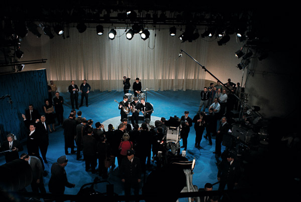 "<div class=""meta image-caption""><div class=""origin-logo origin-image ""><span></span></div><span class=""caption-text"">The British rock and roll group the Beatles, center, are surrounded by photographers on stage at CBS' Studio 50 before their live television appearance on The Ed Sullivan Show in New York City, Feb. 10, 1964. In the front row are, from left, Paul McCartney, George Harrison and John Lennon. Ringo Starr is in background on drums. (AP Photo)    </span></div>"