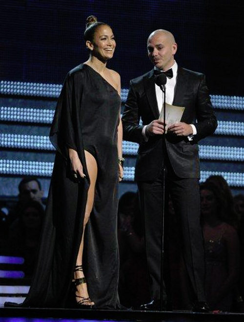 Jennifer Lopez, left, and Pitbull present the award for best pop solo performance at the 55th annual Grammy Awards on Sunday, Feb. 10, 2013, in Los Angeles. (Photo by John Shearer/Invision/AP)
