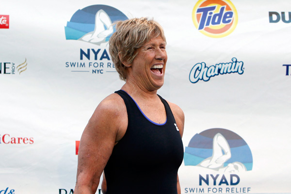 Long-distance swimmer Diana Nyad, who completed a record-breaking swim from Cuba to Florida, smiles as she warms up before beginning a continuous 48-hour swim event in New York&#39;s Herald Square called &#34;Swim for Relief,&#34; which aims to raise funds and awareness for Hurricane Sandy recovery efforts, Tuesday, Oct. 8, 2013. &#40;AP Photo&#47;Jason DeCrow&#41;        <span class=meta>(Rumor: Puredwts.com&#47;Katie)</span>