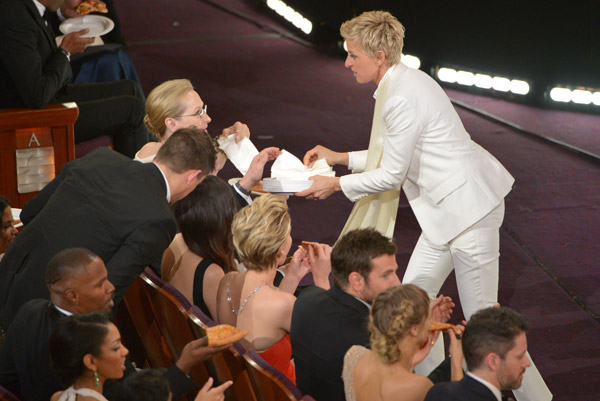 "<div class=""meta ""><span class=""caption-text "">Ellen DeGeneres passes out pizza in the audience during the Oscars at the Dolby Theatre on Sunday, March 2, 2014, in Los Angeles. (Photo by John Shearer/Invision/AP)  </span></div>"