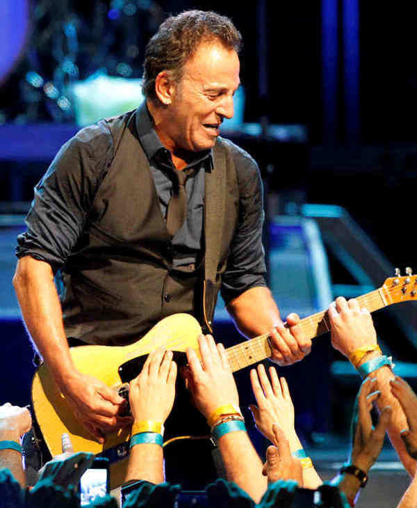 "<div class=""meta ""><span class=""caption-text "">Fans reach up to touch the guitar as Bruce Springsteen and the E Street Band perform during the Wrecking Ball tour at the Wells Fargo Center Wednesday, March 28, 2012 in Philadelphia.  (AP Photo/Alex Brandon)</span></div>"