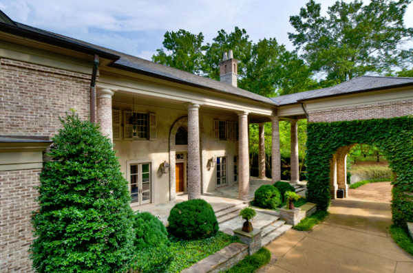 "This 6-acre estate, at 1358 Page Road in Nashville, Tennessee, has been transformed into the home of country-music star Rayna Jaymes, played by Connie Britton in ABC's ""Nashville.""   The home is on the market with an asking price of $19.5 million.  The 20,533 square foot brick home, built in 1999, sits on six acres and has 24 total rooms, including 6 bedrooms, 8 bathrooms and 3 half bathrooms."