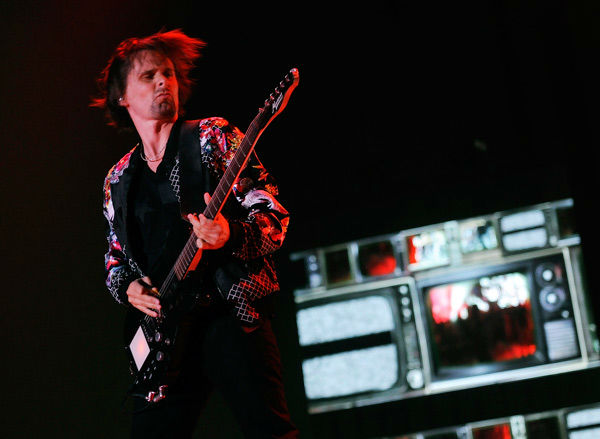 Matt Bellamy of Muse performs during the band&#39;s headlining set on day two of the 2014 Coachella Music and Arts Festival on Saturday, April 12, 2014, in Indio, Calif. &#40;Photo by Chris Pizzello&#47;Invision&#47;AP&#41; <span class=meta>(AP Photo&#47; Chris Pizzello)</span>