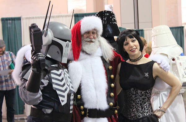Everyone gets along at Comic Con. Even Santa Claus and a goth Boba Fett!