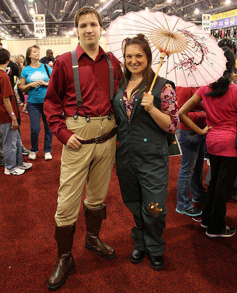 """Captain Tight Pants,"" better known as Capt. Malcom Reynolds, and engineer Kaylee, from the TV series ""Firefly."""