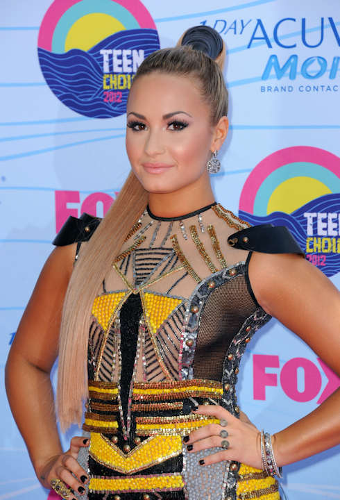 "<div class=""meta ""><span class=""caption-text "">Demi Lovato arrives at the Teen Choice Awards on Sunday, July 22, 2012, in Universal City, Calif. (Photo by Jordan Strauss/Invision/AP) </span></div>"