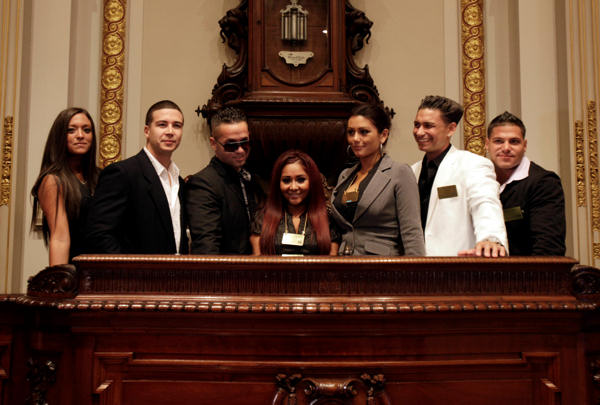 Cast members of MTV&#39;s &#34;Jersey Shore&#34; reality series pose for a photo on the rostrum of the New York Stock Exchange board room before ringing the opening bell, Tuesday, July 27, 2010. They are, from left: Sammi Giancola; Vinny Guadagnino; Michael &#34;The Situation&#34; Sorrentino; Nicole &#34;Snooki&#34; Polizzi; Jenni &#34;J-Woww&#34; Farley; Ronnie Ortiz; ; Pauley &#34;DJ Pauly D&#34; Del Vecchio; Ronnie Ortiz.  <span class=meta>(AP Photo&#47;Richard Drew)</span>