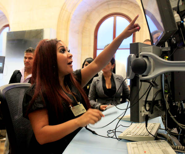 Nicole &#34;Snooki&#34; Polizzi, foreground, and cast members of MTV&#39;s &#34;Jersey Shore&#34; reality series pose for photos on the trading floor after participating in opening bell ceremonies of the New York Stock Exchange Tuesday, July 27, 2010. <span class=meta>(AP Photo&#47;Richard Drew)</span>