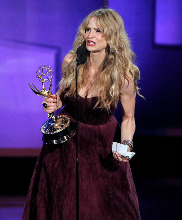 Kyra Sedgwick accepts the award for outstanding lead actress in a drama series during the 62nd Primetime Emmy Awards Sunday, Aug. 29, 2010, in Los Angeles. (AP Photo/Chris Carlson)