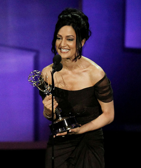 "Archie Panjabi accepts the award for outstanding supporting actress in a drama series for ""The Good Wife"" during the 62nd Primetime Emmy Awards Sunday, Aug. 29, 2010, in Los Angeles. (AP Photo/Chris Carlson)"