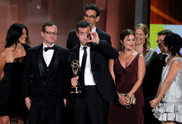 "Cast and crew of ""The Daily Show with Jon Stewart"" accept the award for outstanding variety, music or comedy special during the 62nd Primetime Emmy Awards Sunday, Aug. 29, 2010, in Los Angeles. (AP Photo/Chris Carlson)"