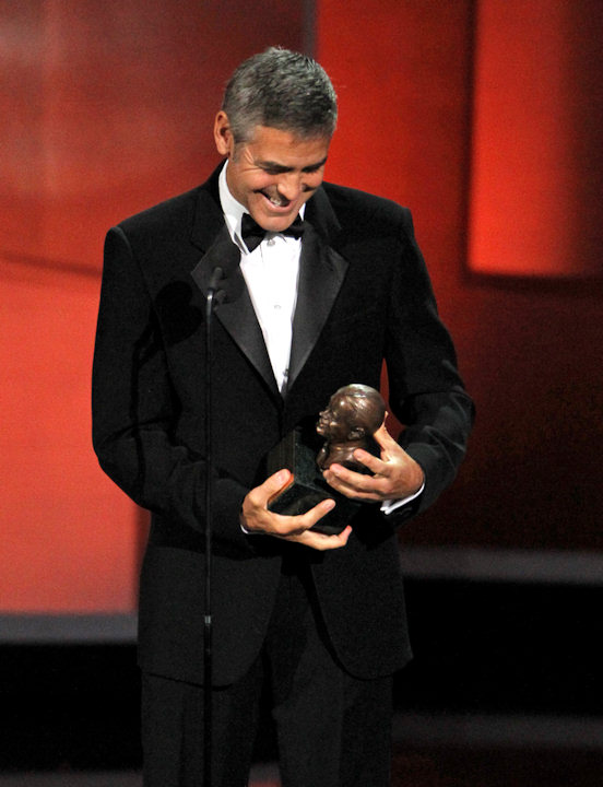 George Clooney accepts the Bob Hope Humanitarian Award during the 62nd Primetime Emmy Awards Sunday, Aug. 29, 2010, in Los Angeles. (AP Photo/Chris Carlson)