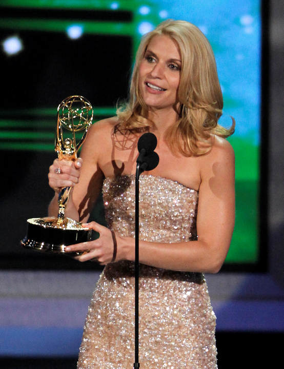 Claire Danes accepts the award for outstanding lead actress in a miniseries or movie during the 62nd Primetime Emmy Awards Sunday, Aug. 29, 2010, in Los Angeles. (AP Photo/Chris Carlson)
