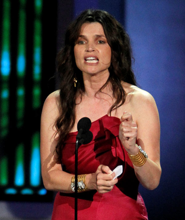 "Julia Ormond accepts the award for outstanding supporting actress in a miniseries or movie for ""Temple Grandin"" during the 62nd Primetime Emmy Awards Sunday, Aug. 29, 2010, in Los Angeles. (AP Photo/Chris Carlson)"
